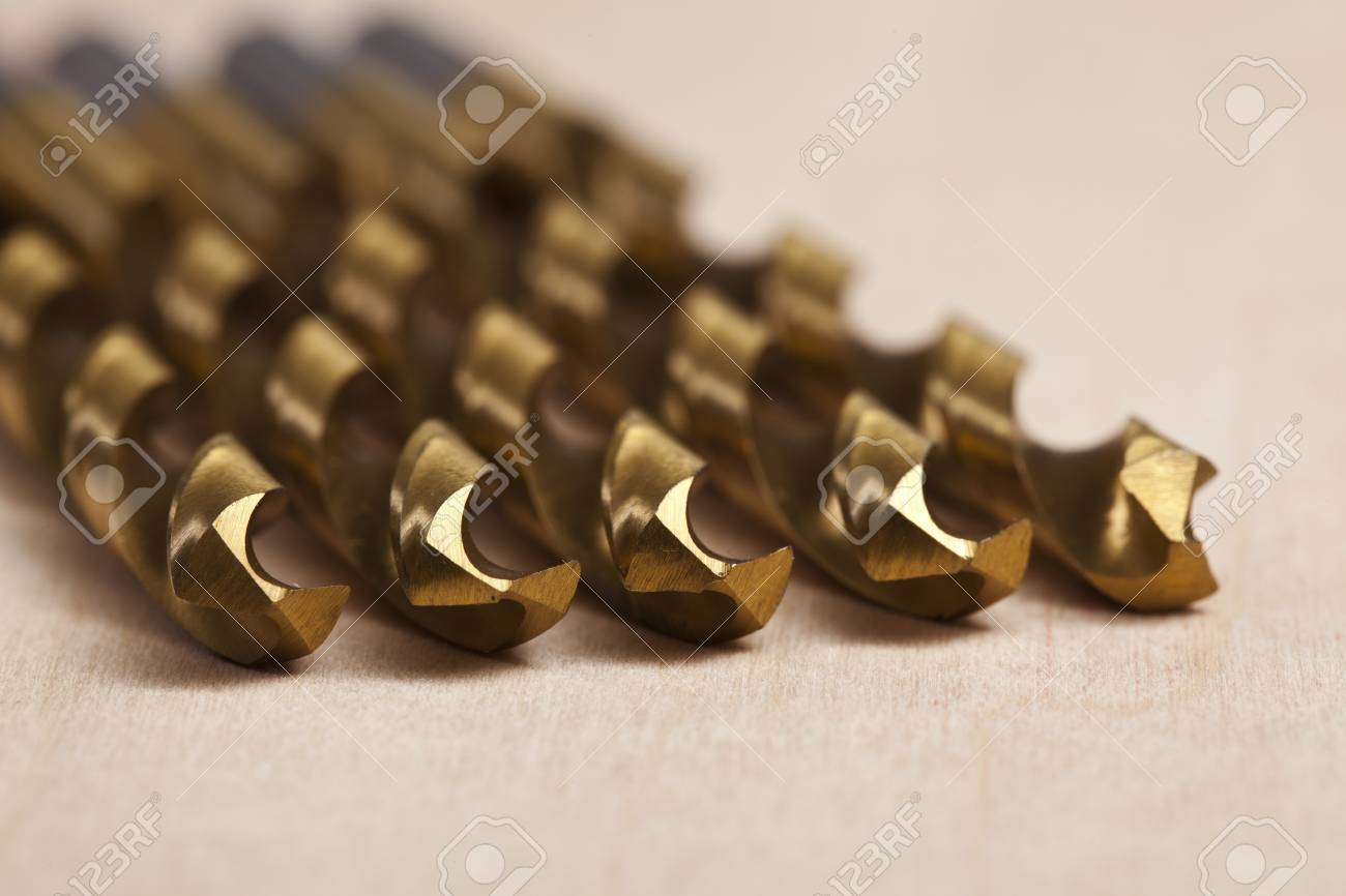 Macro image of Drill bits over a wooden background Stock Photo - 17143860