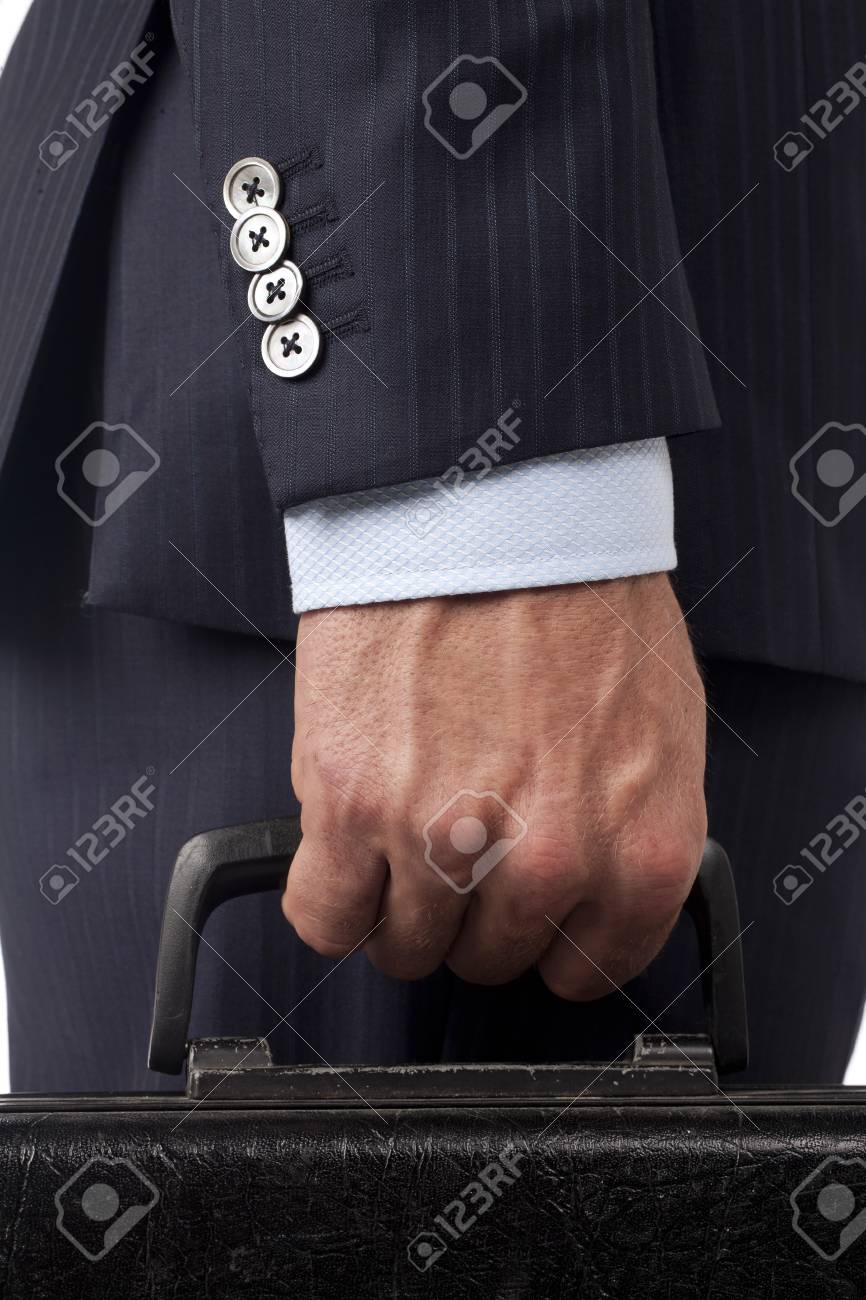 Closed up businessman hand holding a black suitcase Stock Photo - 17169043