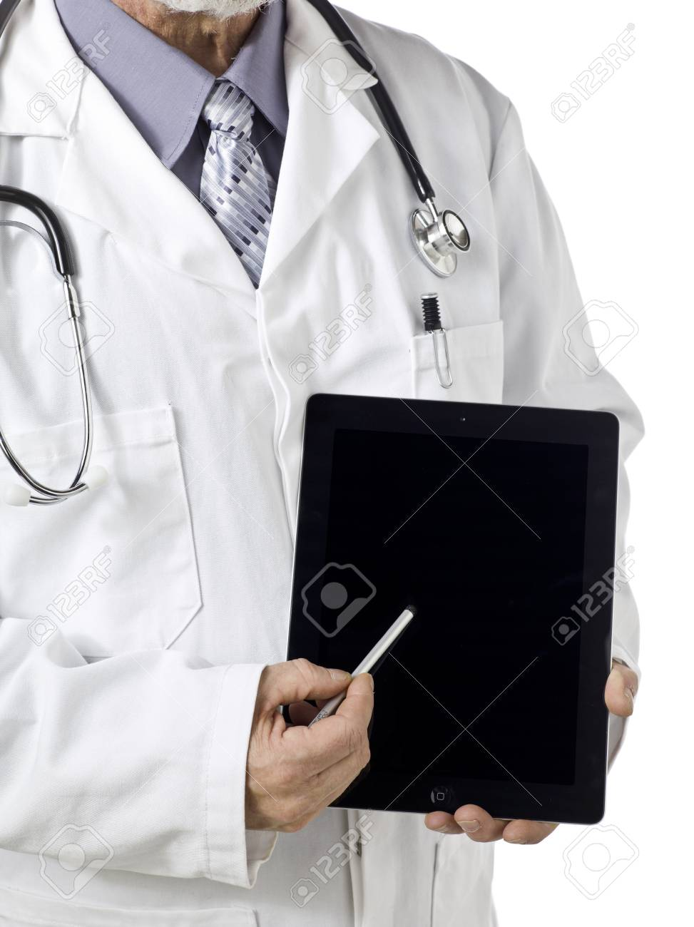 Cropped image of a senior male doctor with the camera focused on his touch pad tablet Stock Photo - 17153555