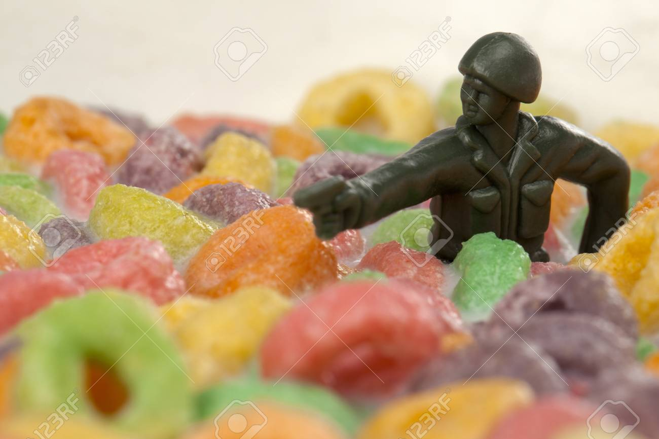 Toy soldier half dipped in cereals Stock Photo - 17168246