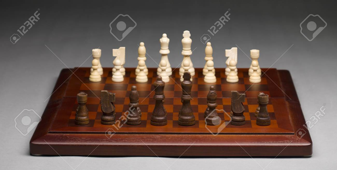 Chess pieces on a wooden chess board Stock Photo - 17183899