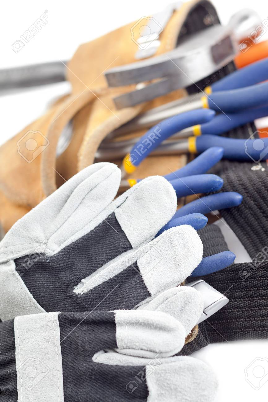 A vertical close-up shot of construction tools and gloves on a white background Stock Photo - 17184037