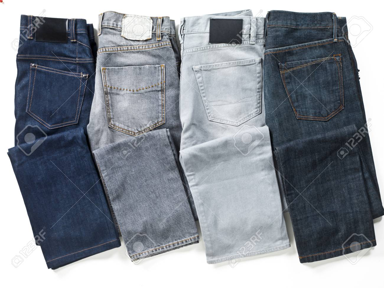 Jeans arranged in a row over white background. Stock Photo - 17209597