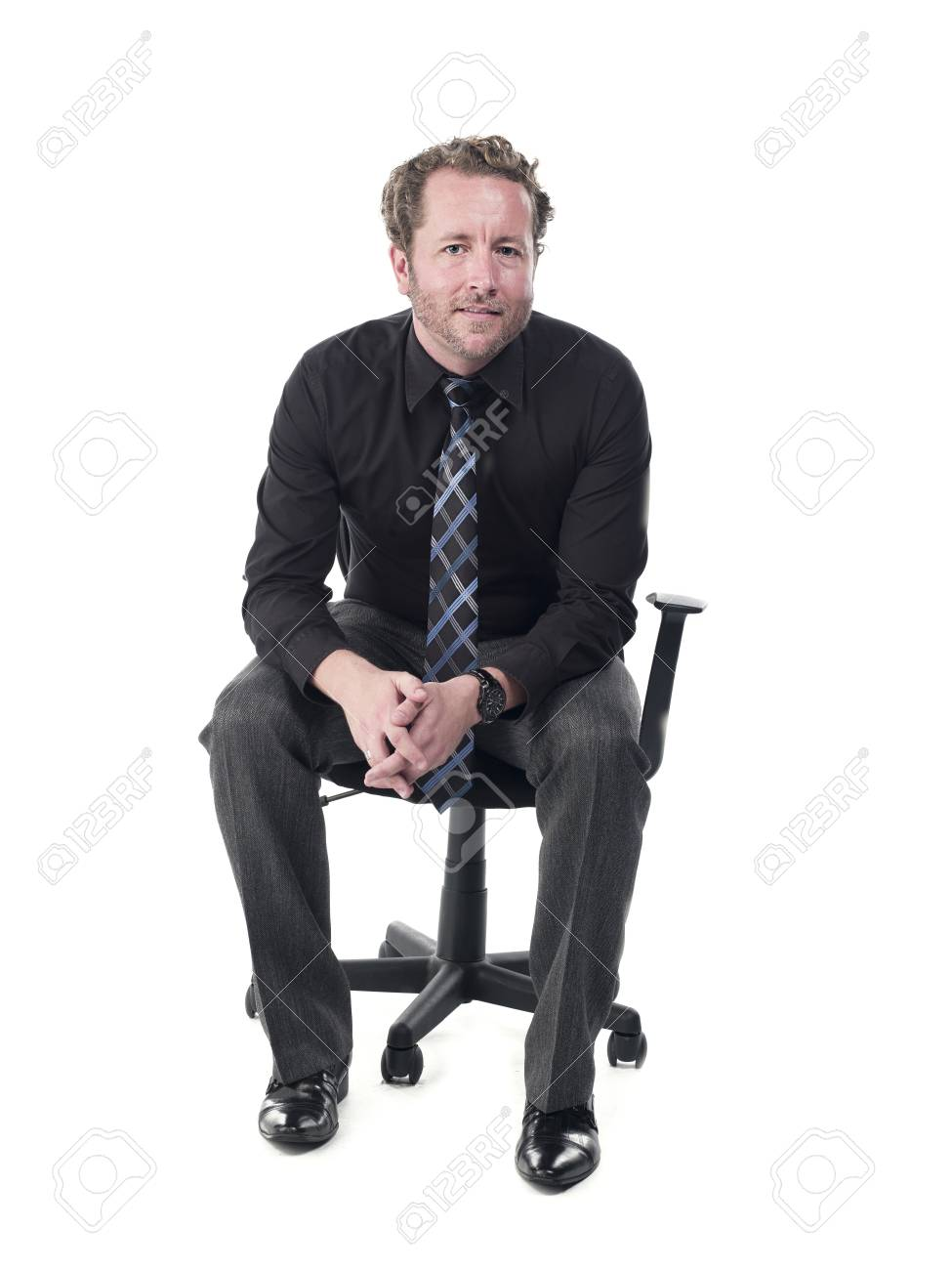 Portrait of a young doctor sitting on chair against white background, Model: Derek Gerhardt Stock Photo - 17244320
