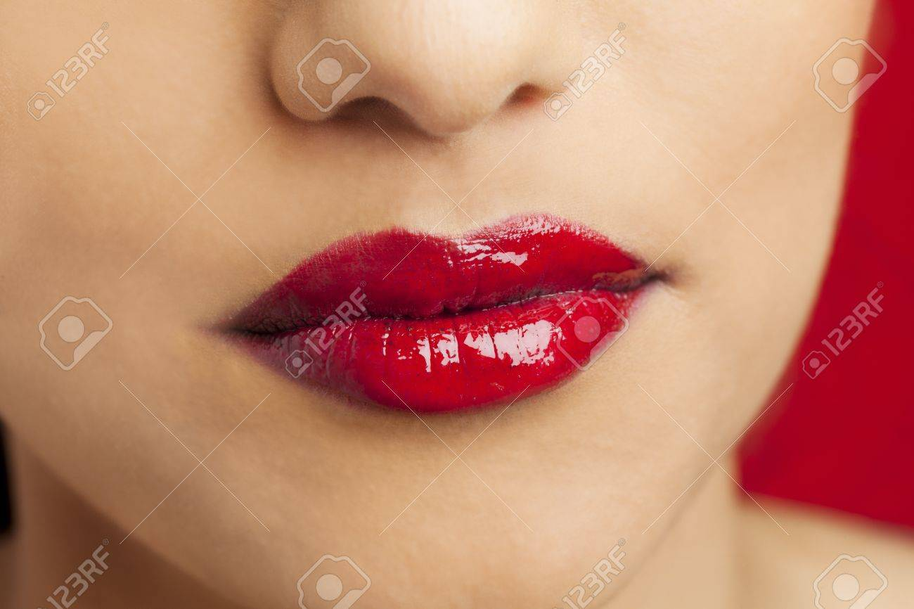 Detailed shot of woman lips with red glossy lipstick, Kiran Bahugun Stock Photo - 17244516