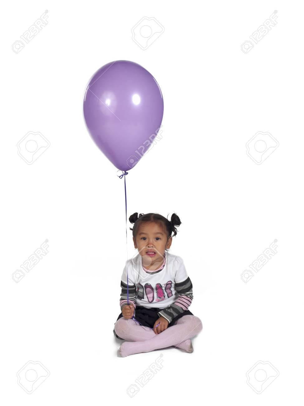 Cute little Asian girl holding balloon over white background, Stock Photo - 17244666