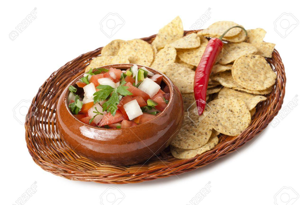 Image of fresh salsa dip with nachos wicker plate against against white background Stock Photo - 17252430
