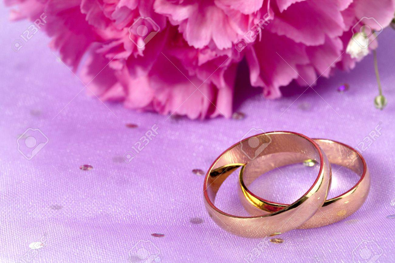 Golden Wedding Ring With A Cropped Image Of Pink Flower On The ...