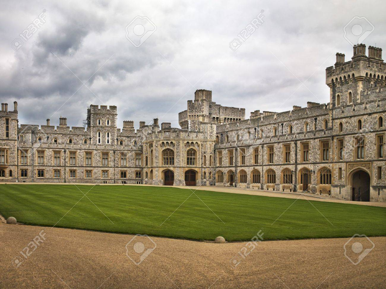 A courtyard at Windsor castle with very well kept grass on the outskirts of  London,