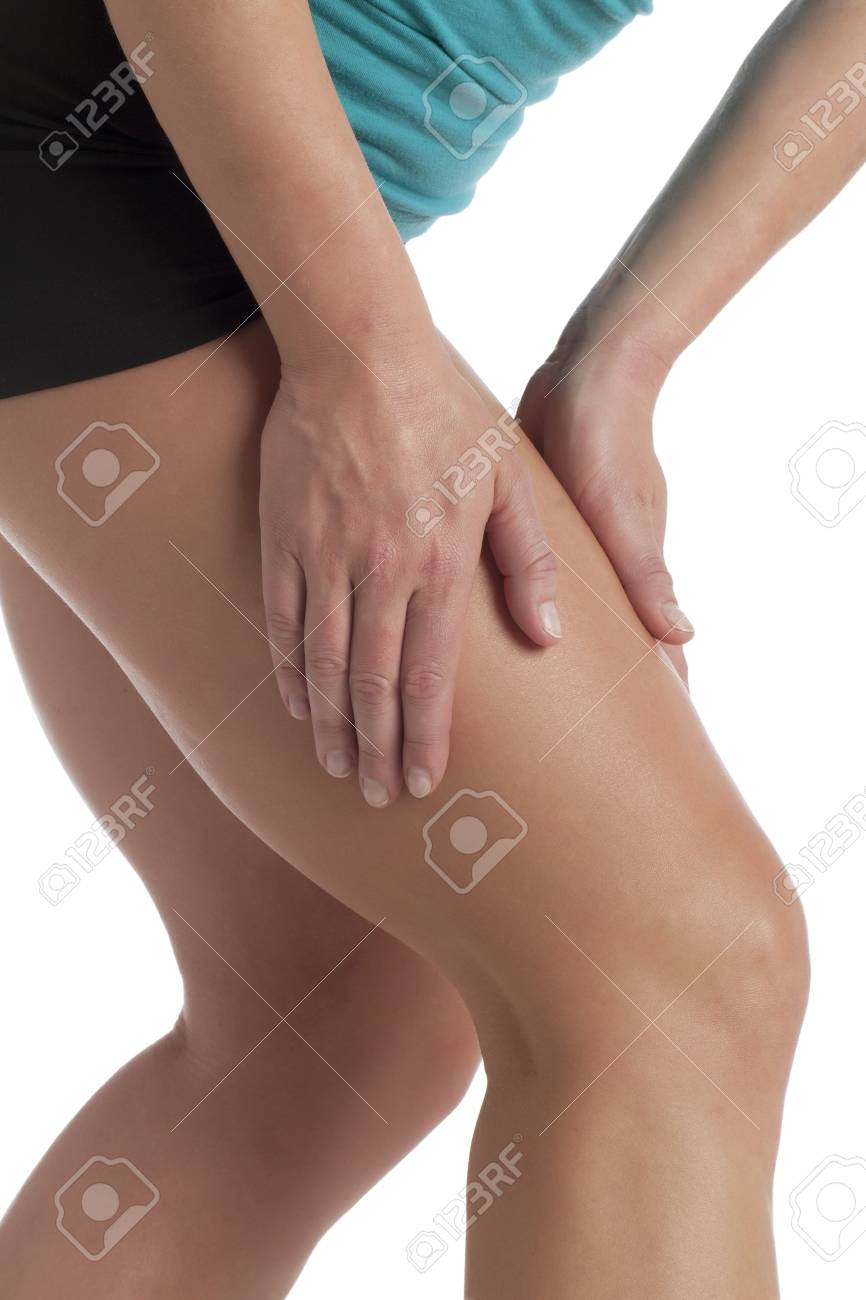 Closed up shot of a woman holding her painful leg Stock Photo - 17323642