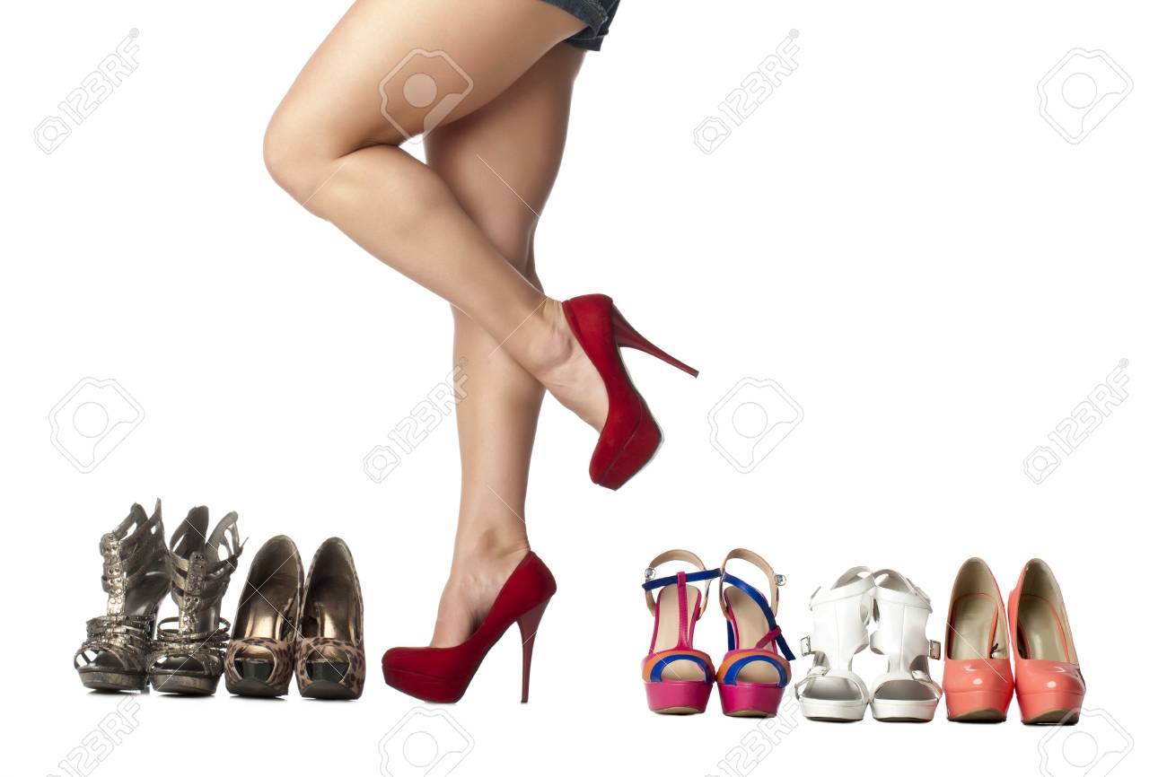 Collection of fashionable female's shoes arranged over a white background Stock Photo - 17351443