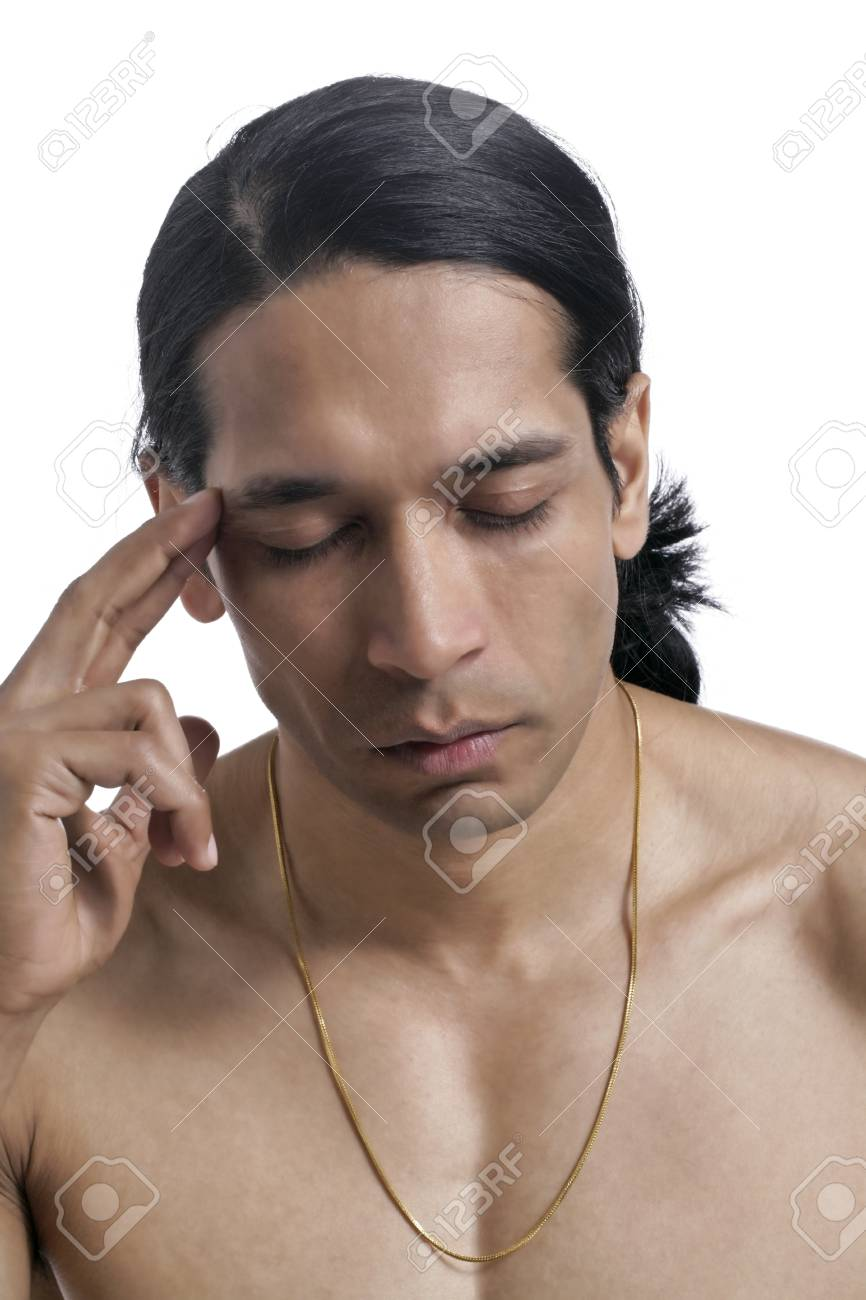 Close-up image of a male with head ache over the white background Stock Photo - 17367383
