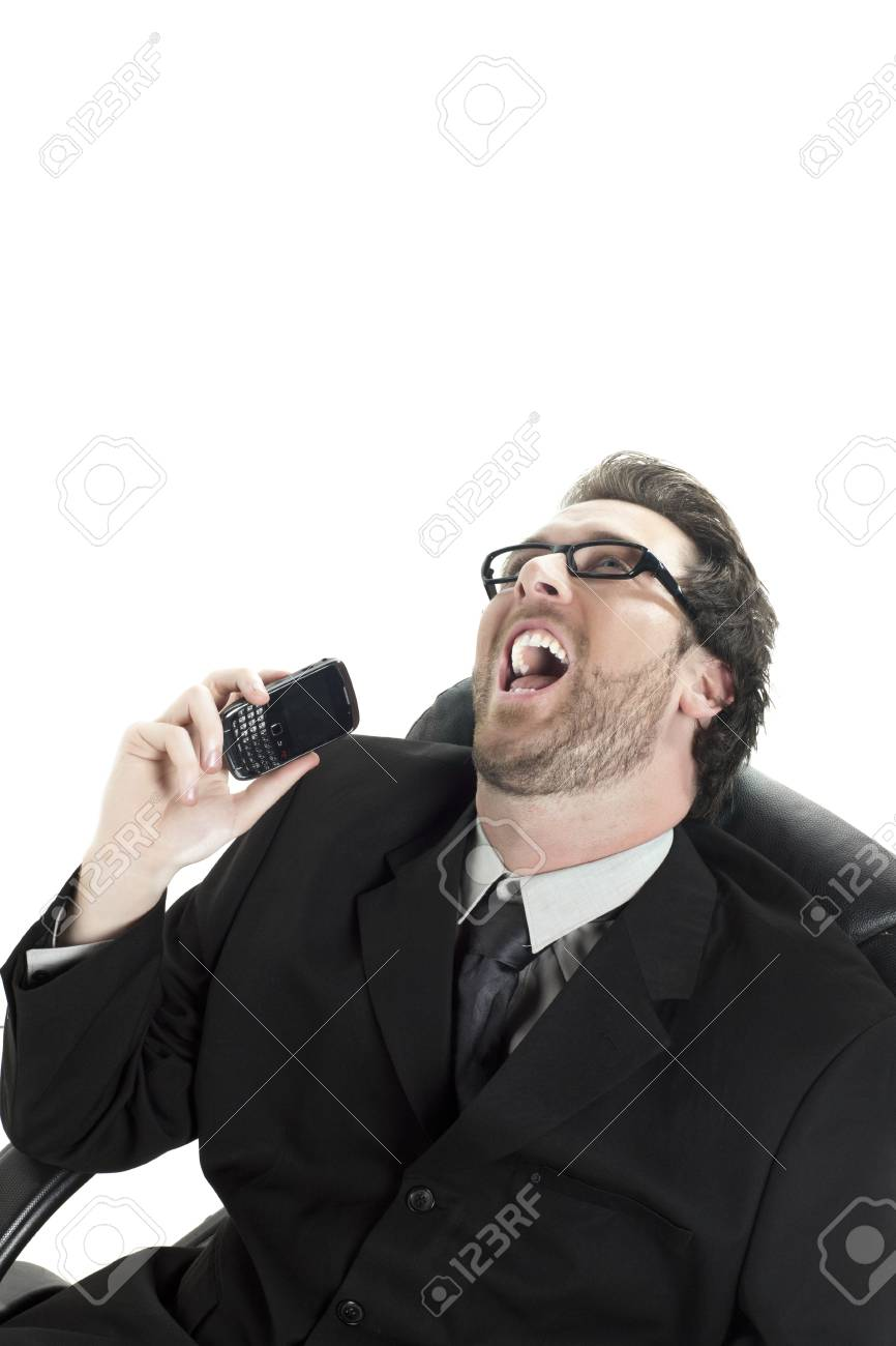 Close up image of businessman laughing while holding a phone against white background Stock Photo - 17367384
