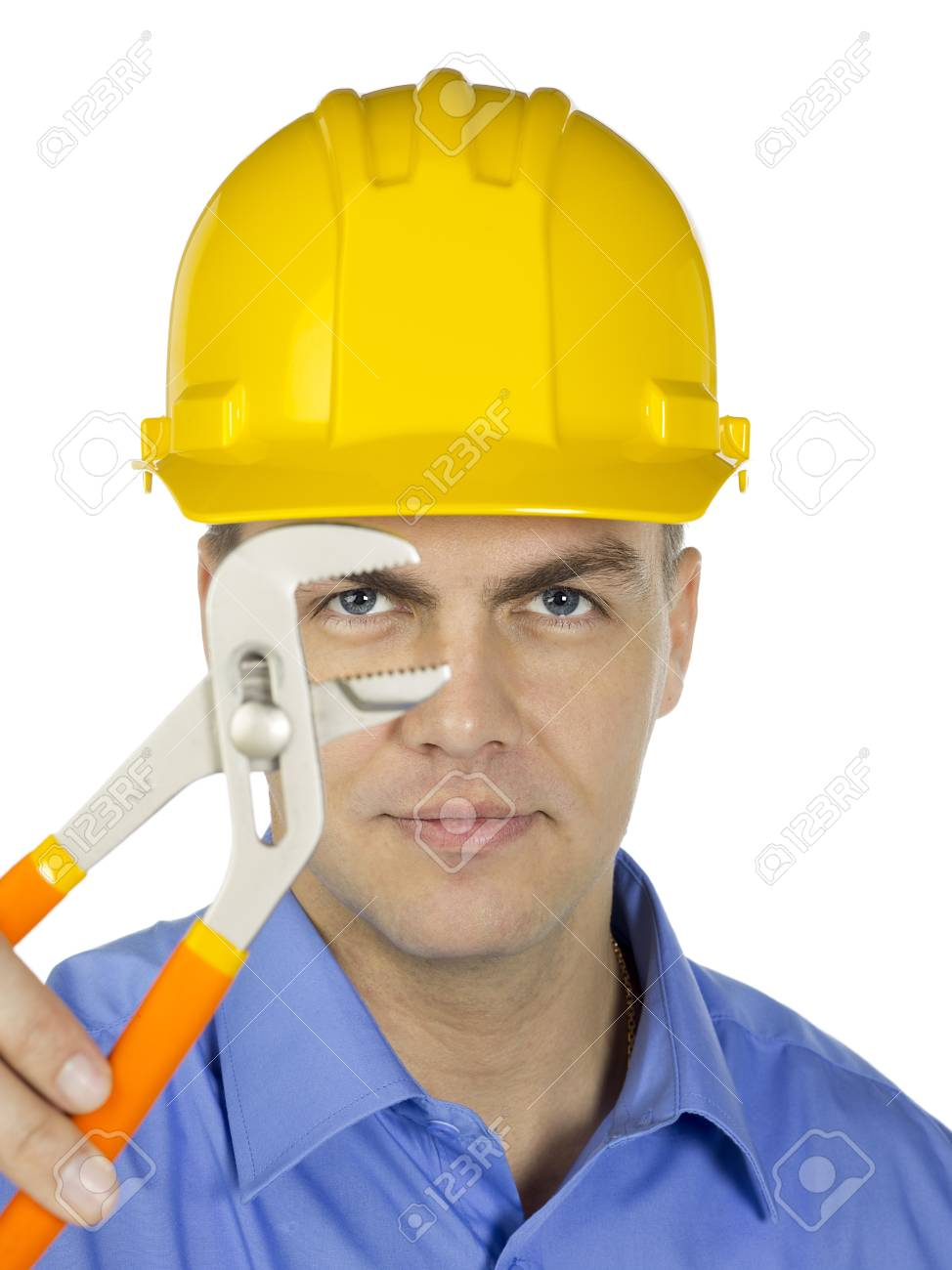 Businessman wearing a yellow hard hat with adjustable wrench Stock Photo - 17368474