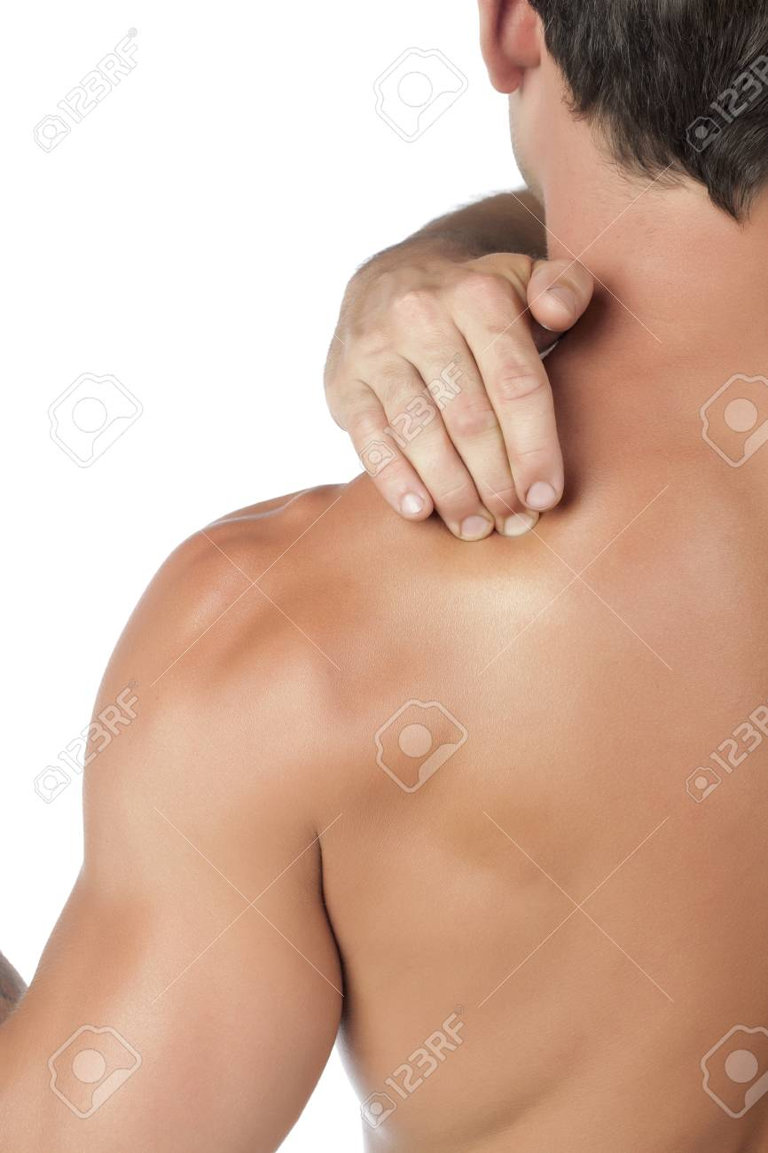 Portrait of man holding his shoulder as a sign of shoulder pain Stock Photo - 17367299