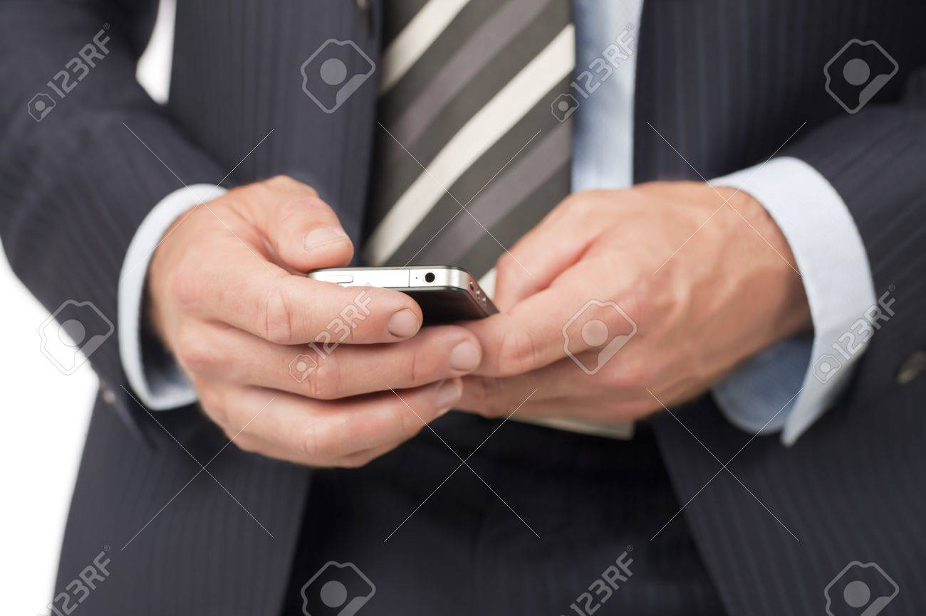 Closeup cropped shot of a man in suit texting through his cellphone Stock Photo - 17400420