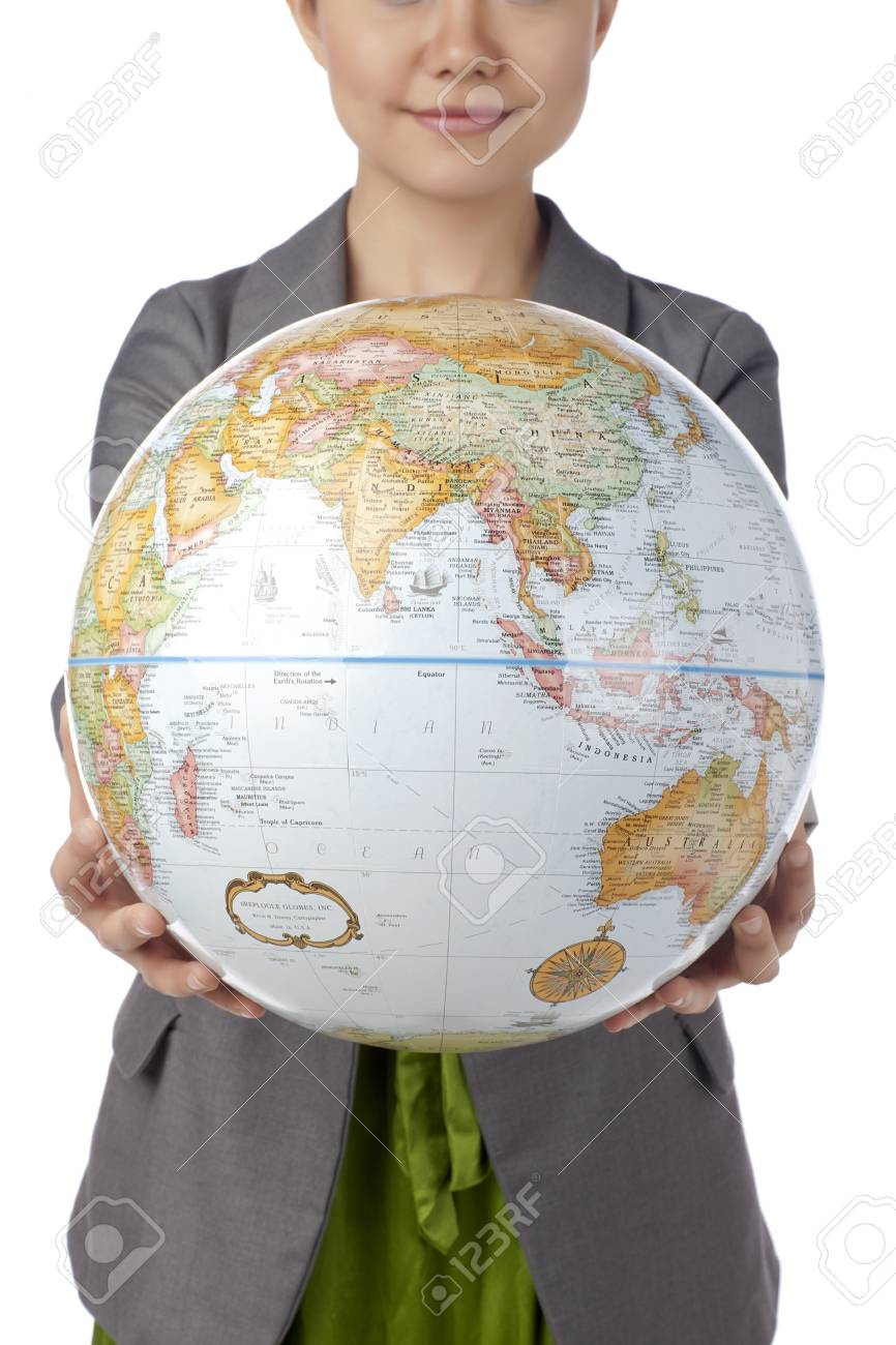 Close-up image of a woman holding the globe isolated on a white background Stock Photo - 17400430