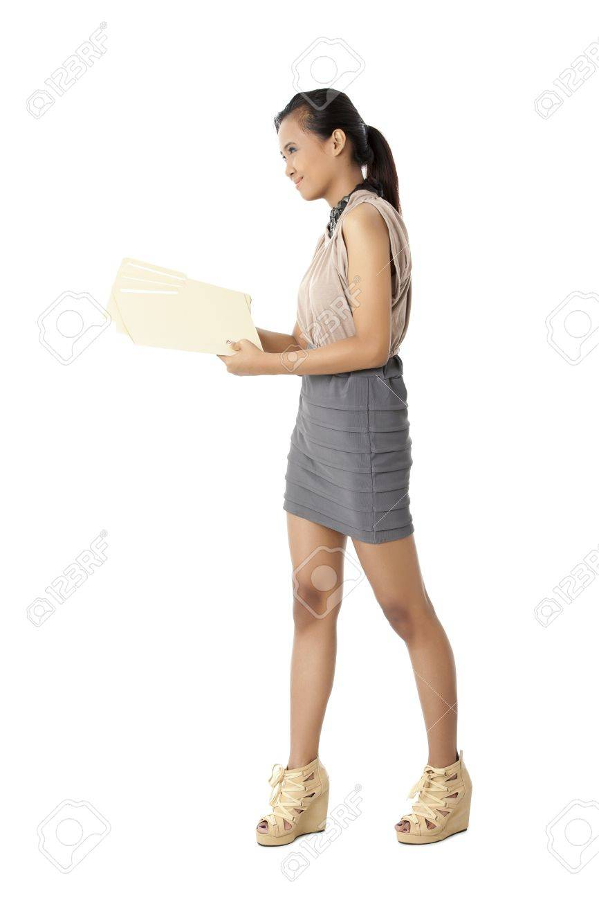 Portrait of office girl smiling while holding documents against white background Stock Photo - 17391858