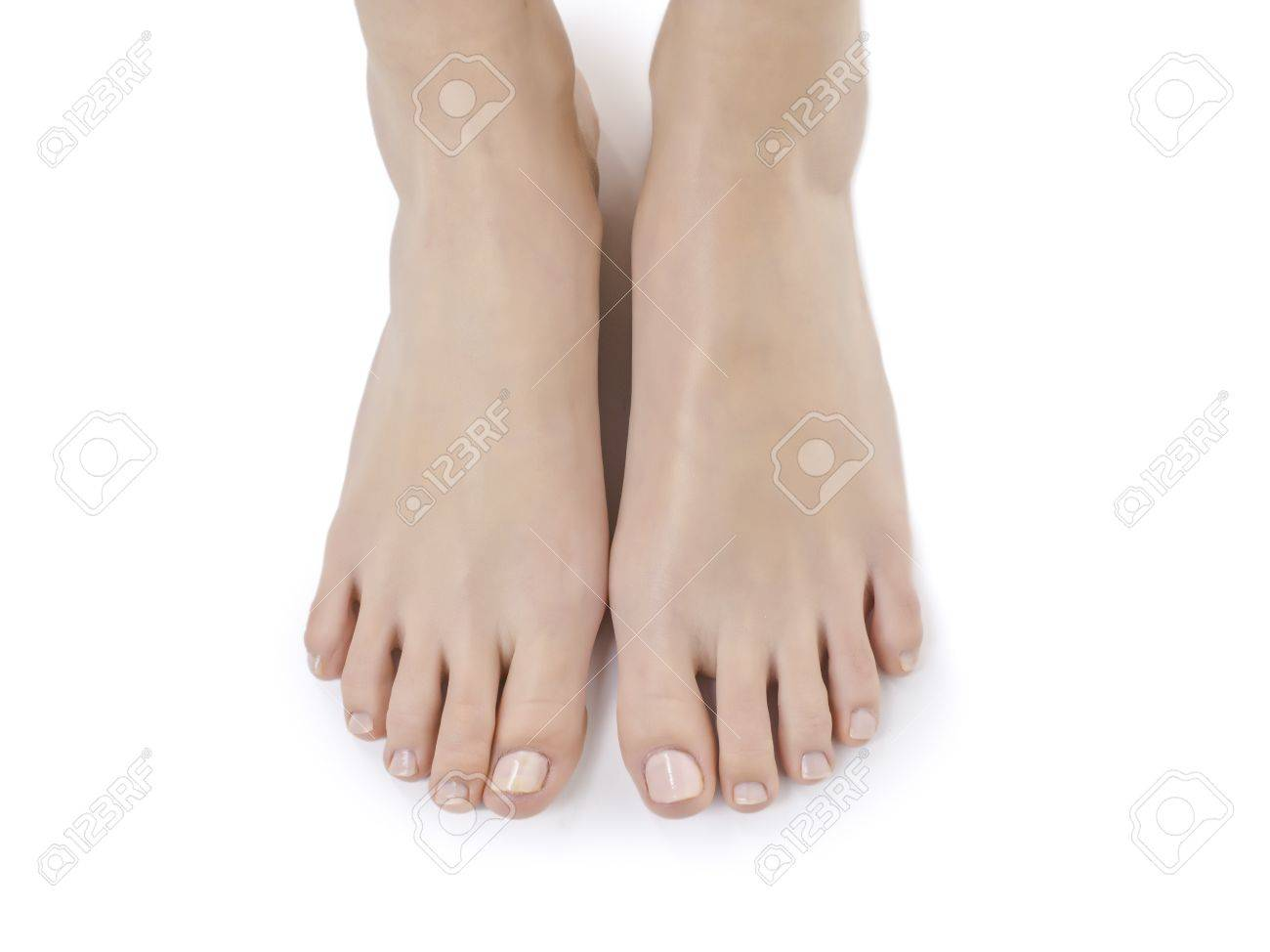 A woman's feet against white background - 17395414