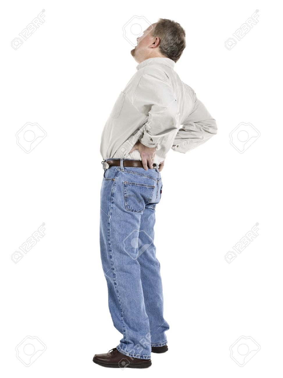 Image of an old man holding his lower back suffering from back pain Stock Photo - 17493155