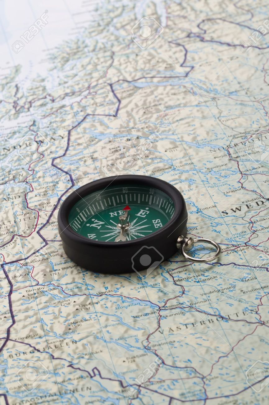 Portrait Image Of A Compass With The World Map On The Background