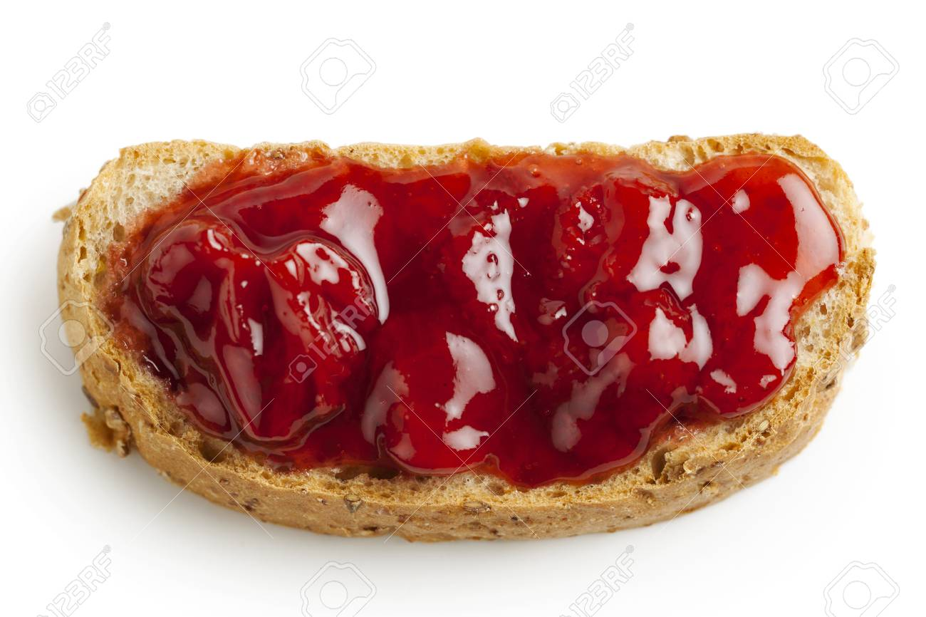 Close-up image of wheat toast and strawberry jam on white Stock Photo - 17489548