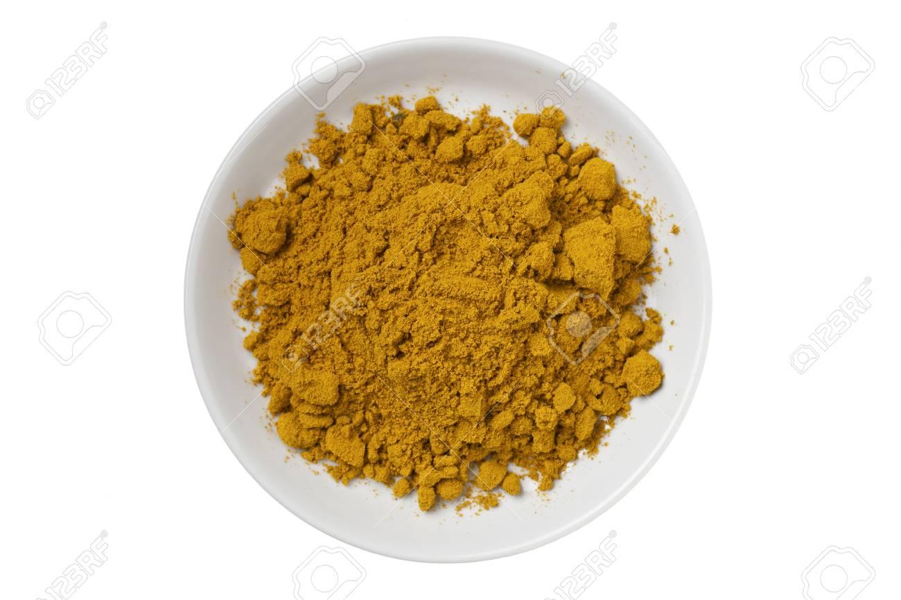 Curry powder on a white bowl Stock Photo - 17494779