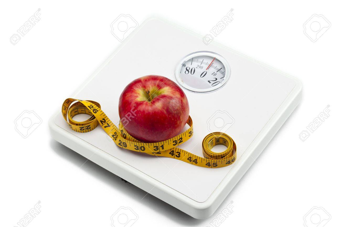 Image of weight scale, red apple and measuring tape isolated on white background - 17516444
