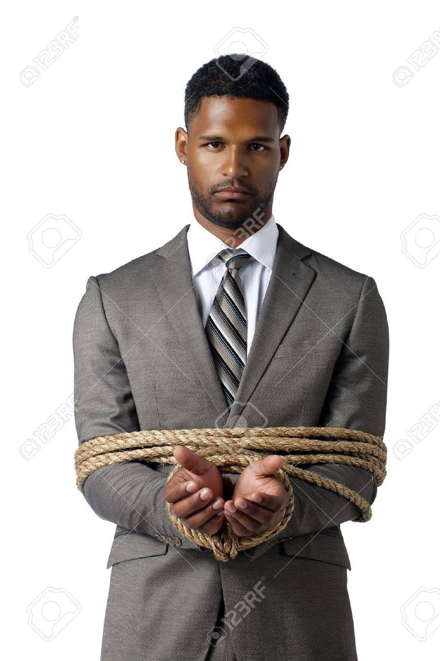 Portrait of serious businessman wrapped up with brown rope against white background Stock Photo - 17519288
