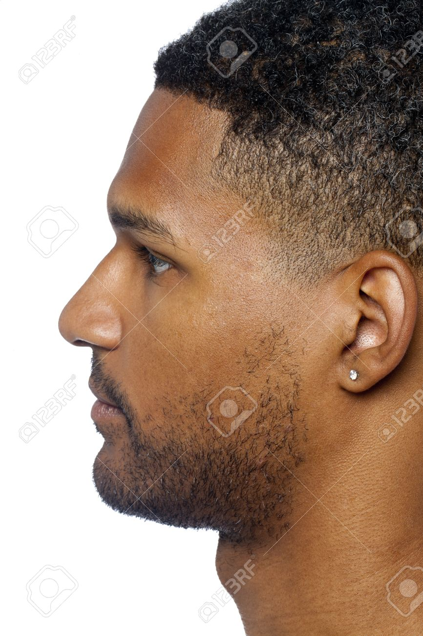 4cc8af8e1 Dark man with ear pierced on side view isolated on a white surface Stock  Photo -