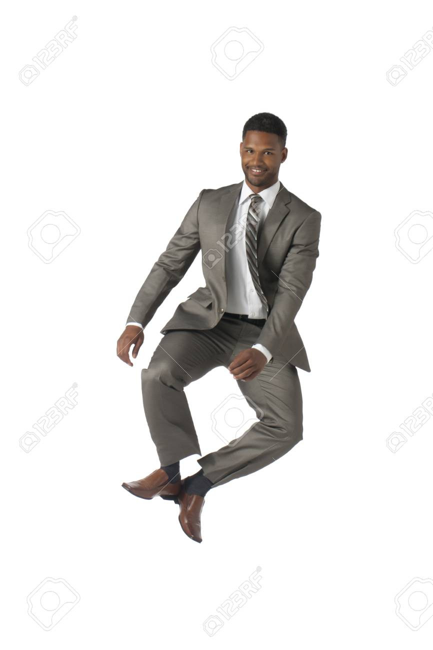 Portrait of happy businessman jumping against white background Stock Photo - 17519335