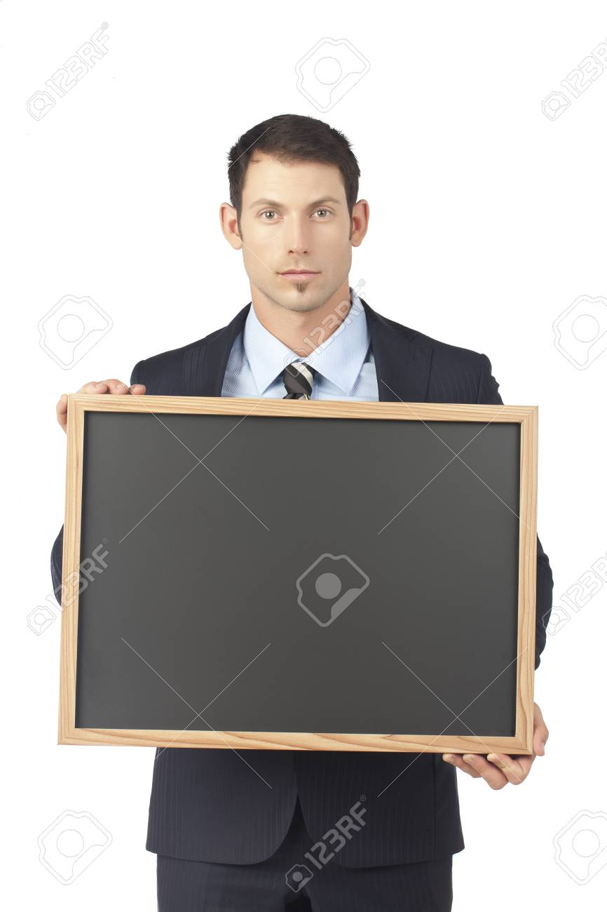 Serious businessman holding a blackboard Stock Photo - 17520756