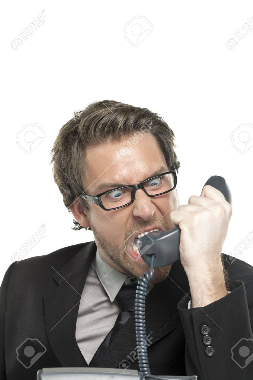 Close-up image of angry businessman shouting on the telephone isolated on a white background Stock Photo - 17521119