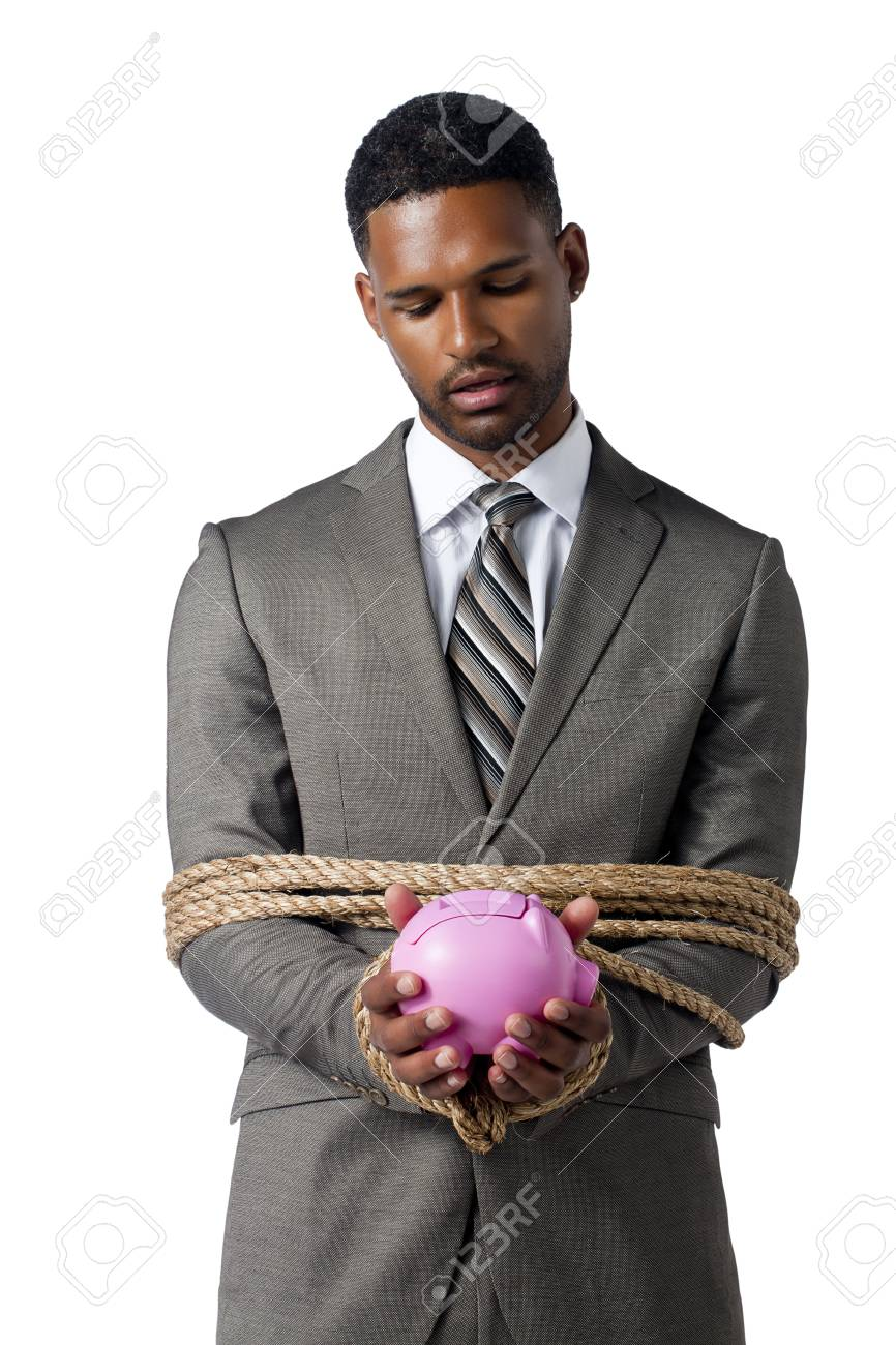 Business crisis concept represented by a tied businessman holding a piggy bank Stock Photo - 17516316