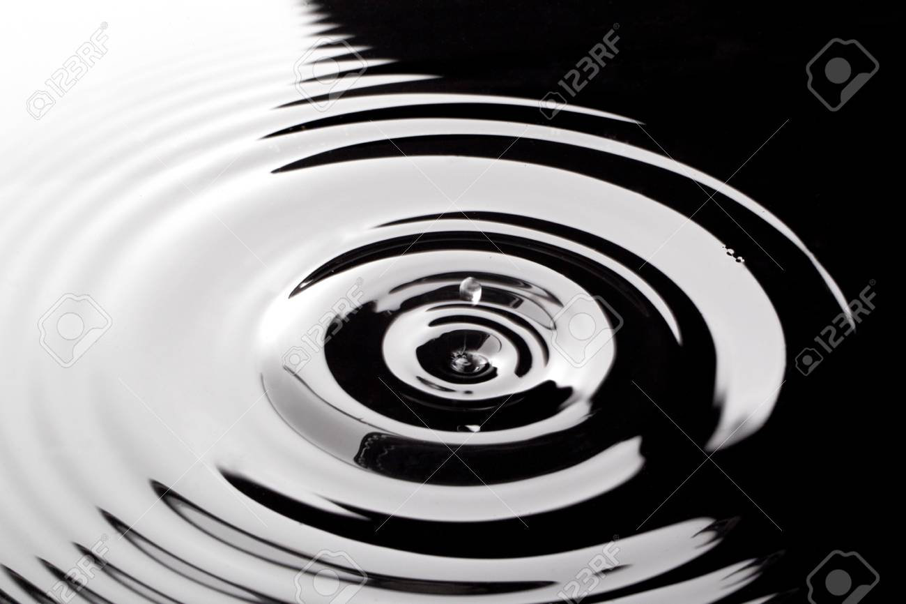 Close up image of drops of water into black water Stock Photo - 17521024