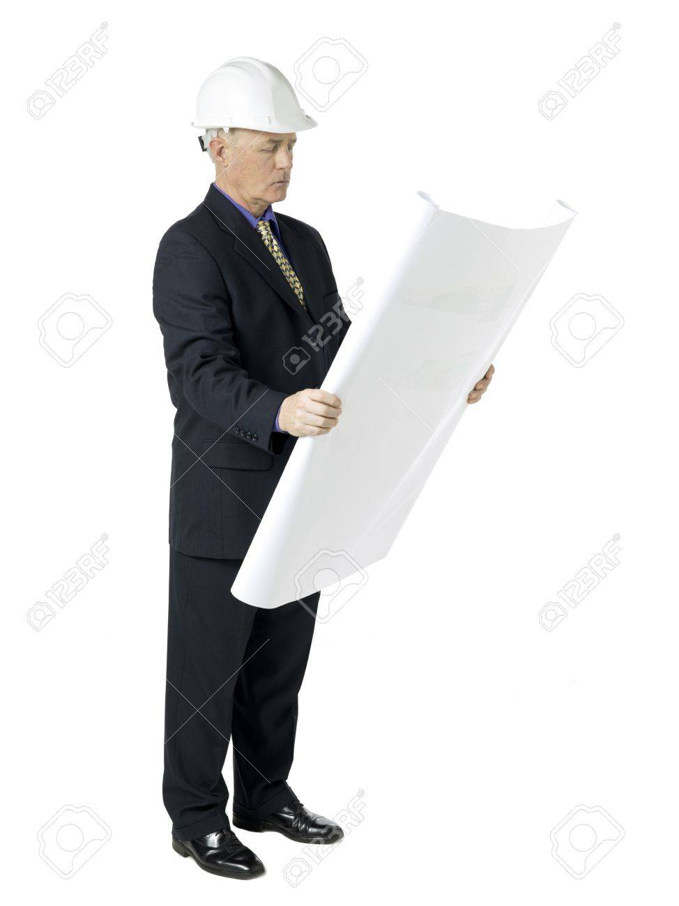Side view image of an architecture wearing white hard hat and side view image of an architecture wearing white hard hat and reading blueprint paper stock malvernweather Choice Image