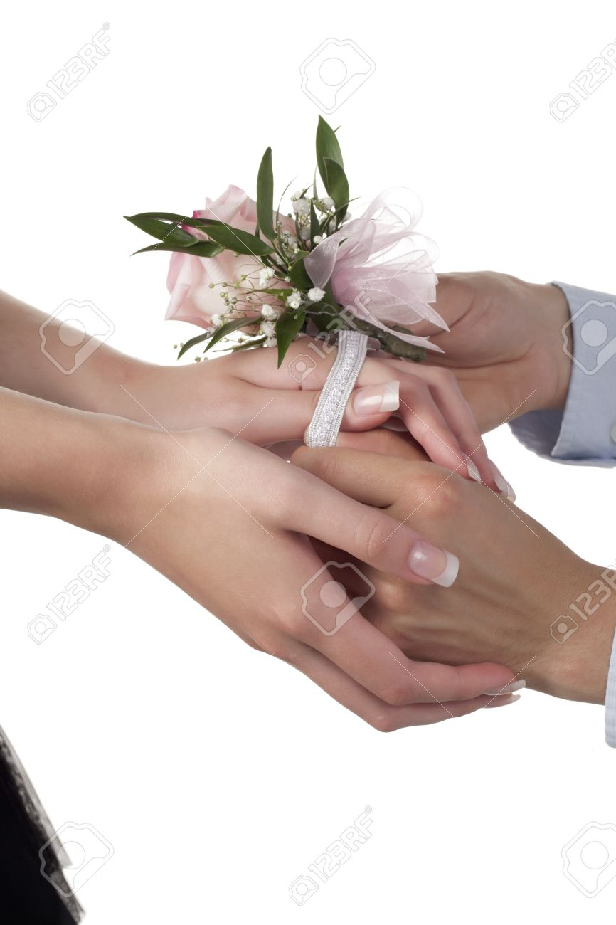 Image of a hand while putting pink flower corsage on the womans image of a hand while putting pink flower corsage on the womans wrist stock photo mightylinksfo
