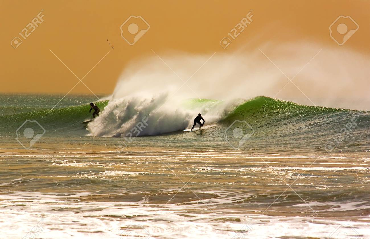 Two Surfers On A Wave In A Fantasy Shot