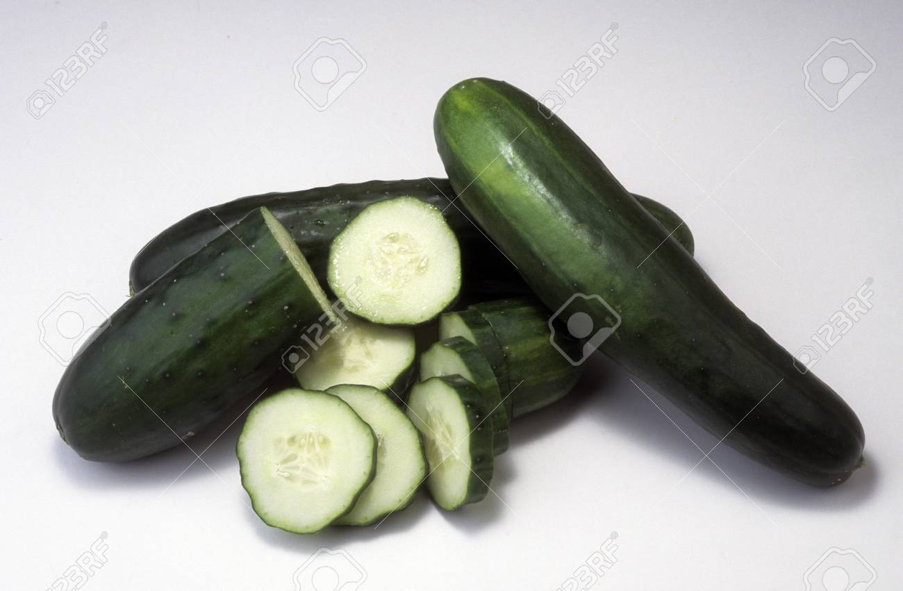 Cucumbers whole and sliced showing crossections. Stock Photo - 11410551