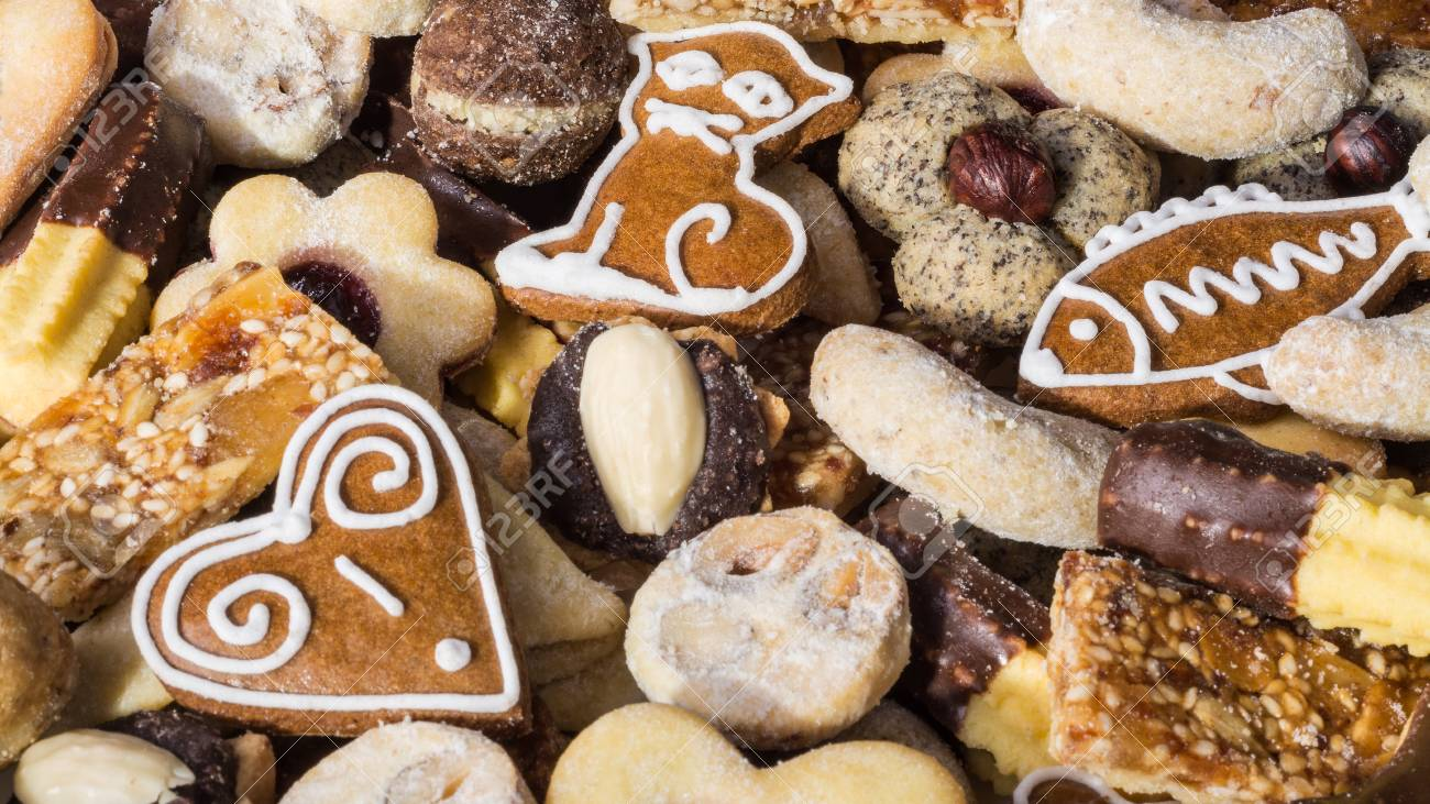 Close Up Of Traditional Homemade Christmas Cookies Heap Of Ornate
