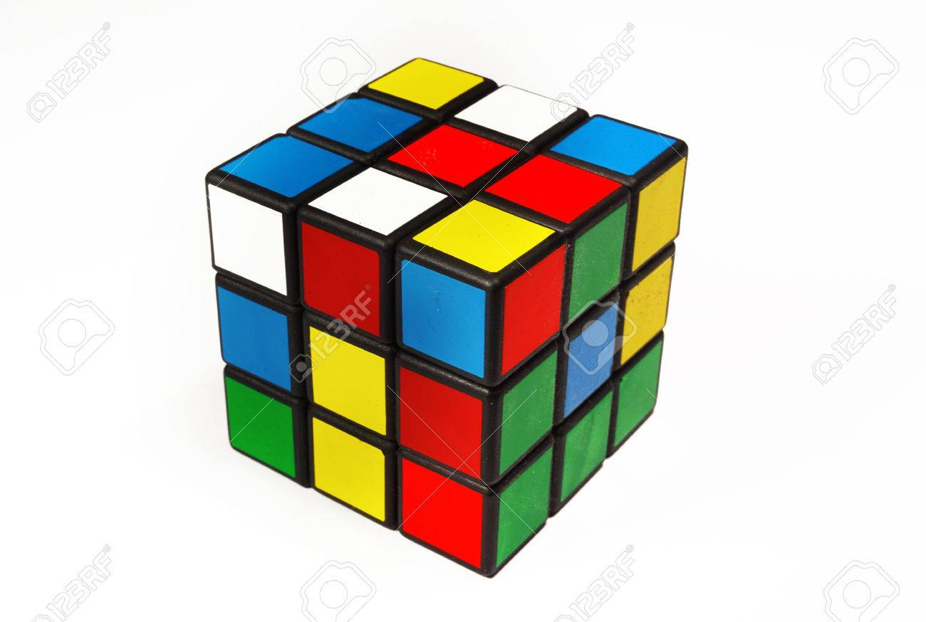 Colorful and world famous Rubik's cube in a scrambled state on a white background - 87374283