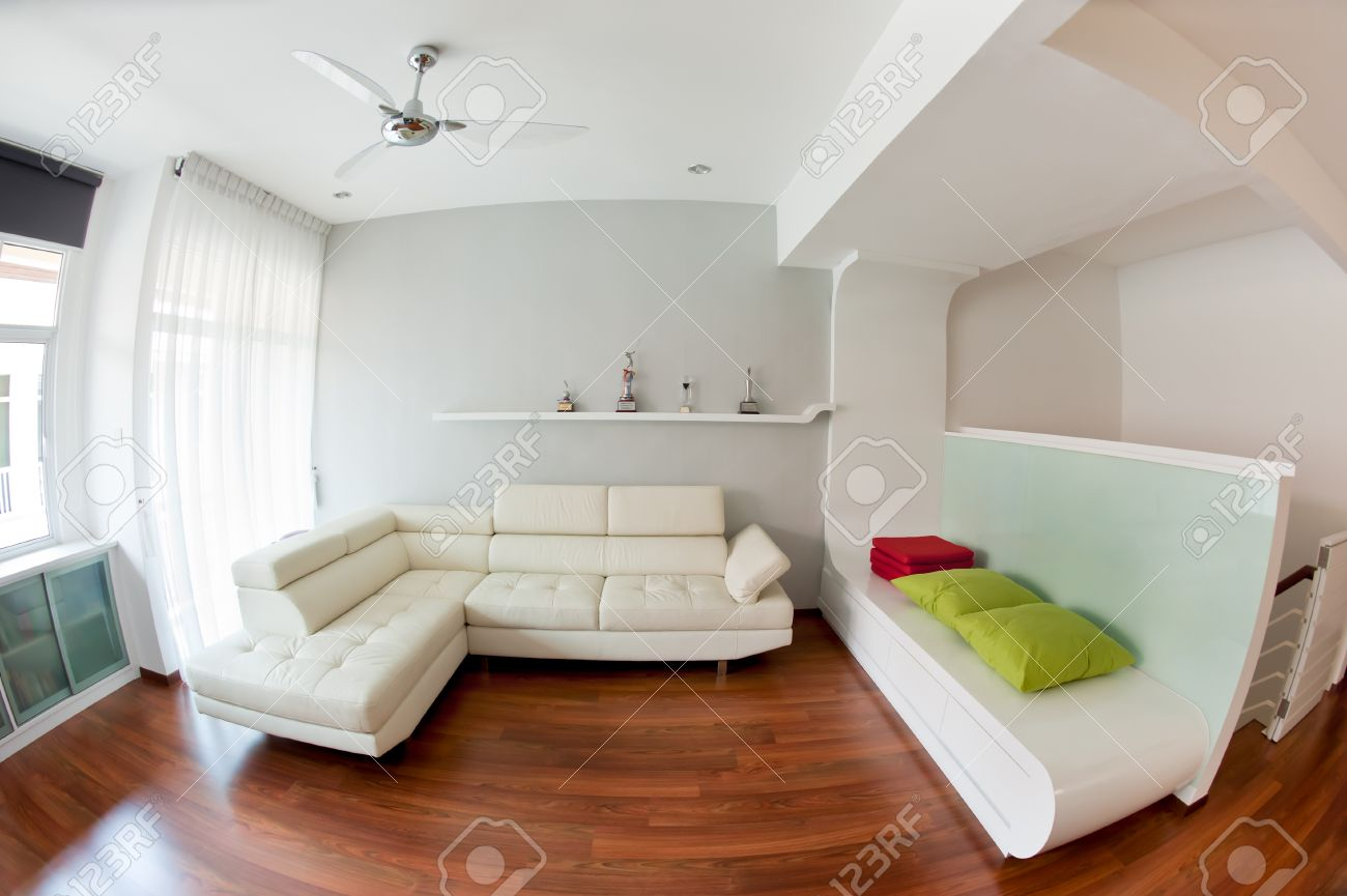 White Couch Living Room Modern Living Room With White Sofa Wooden Floor And Golf Trophy