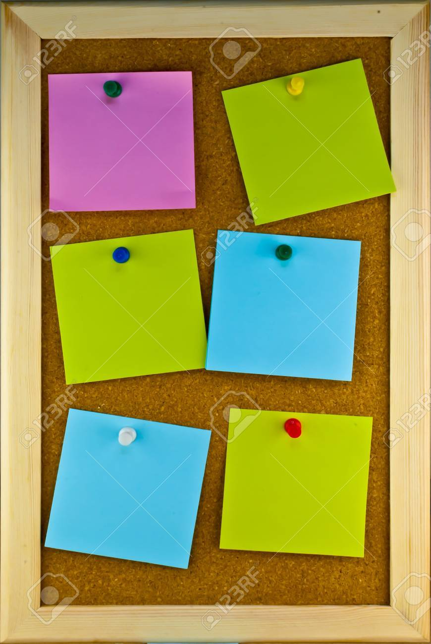 Six post-it note scatering on cork board Stock Photo - 17119319
