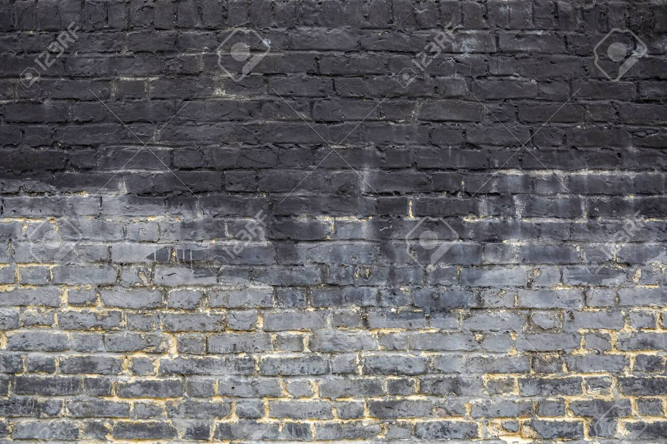 Old grey brick wall background texture close up. - 142556498