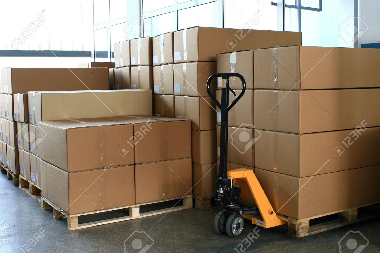 fork pallet truck stacker in warehouse in front of cardboard boxes Stock Photo - 7164067