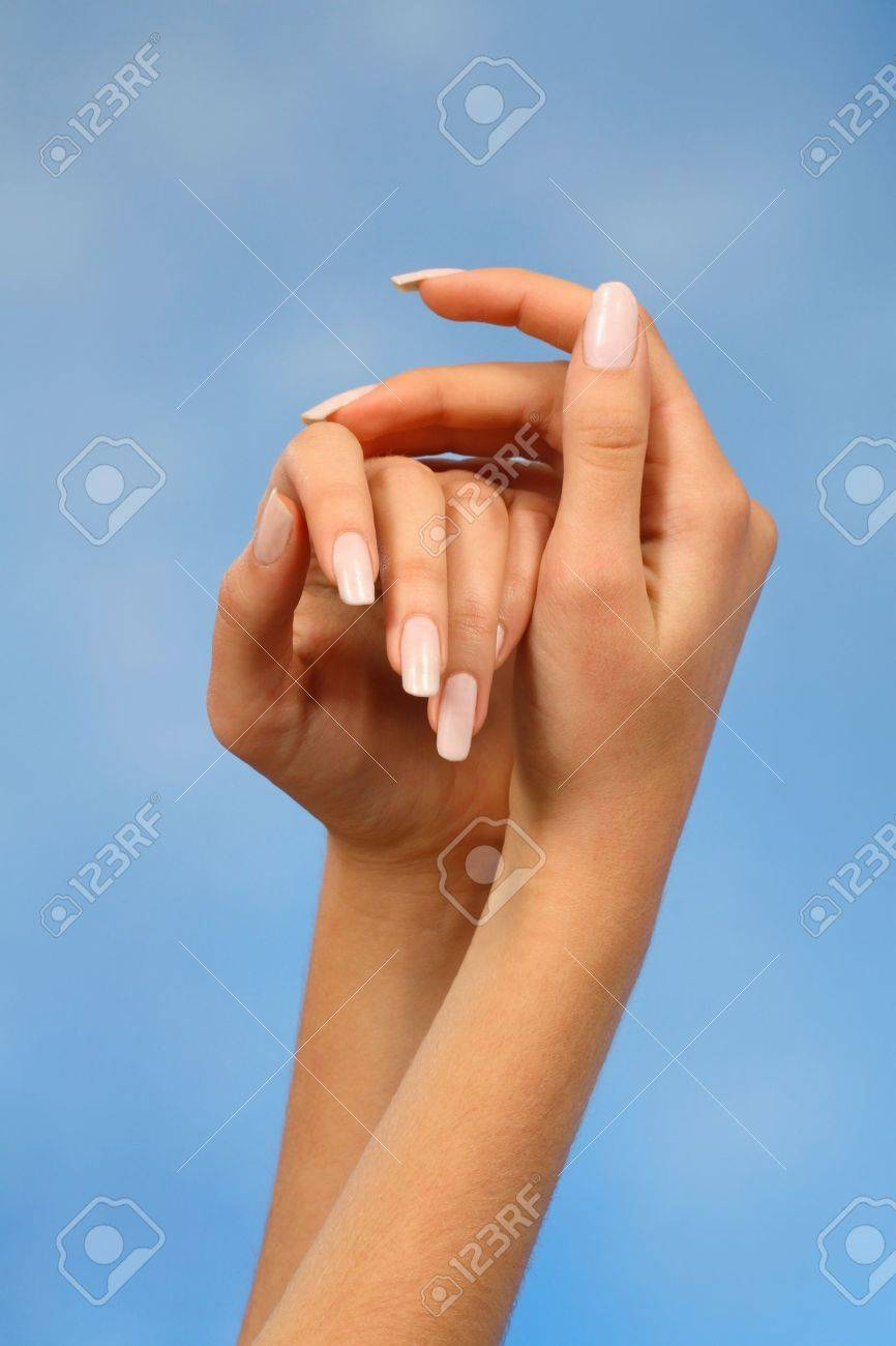 Close-ups Of The Hands Of A Young Woman With Long White Nails ...