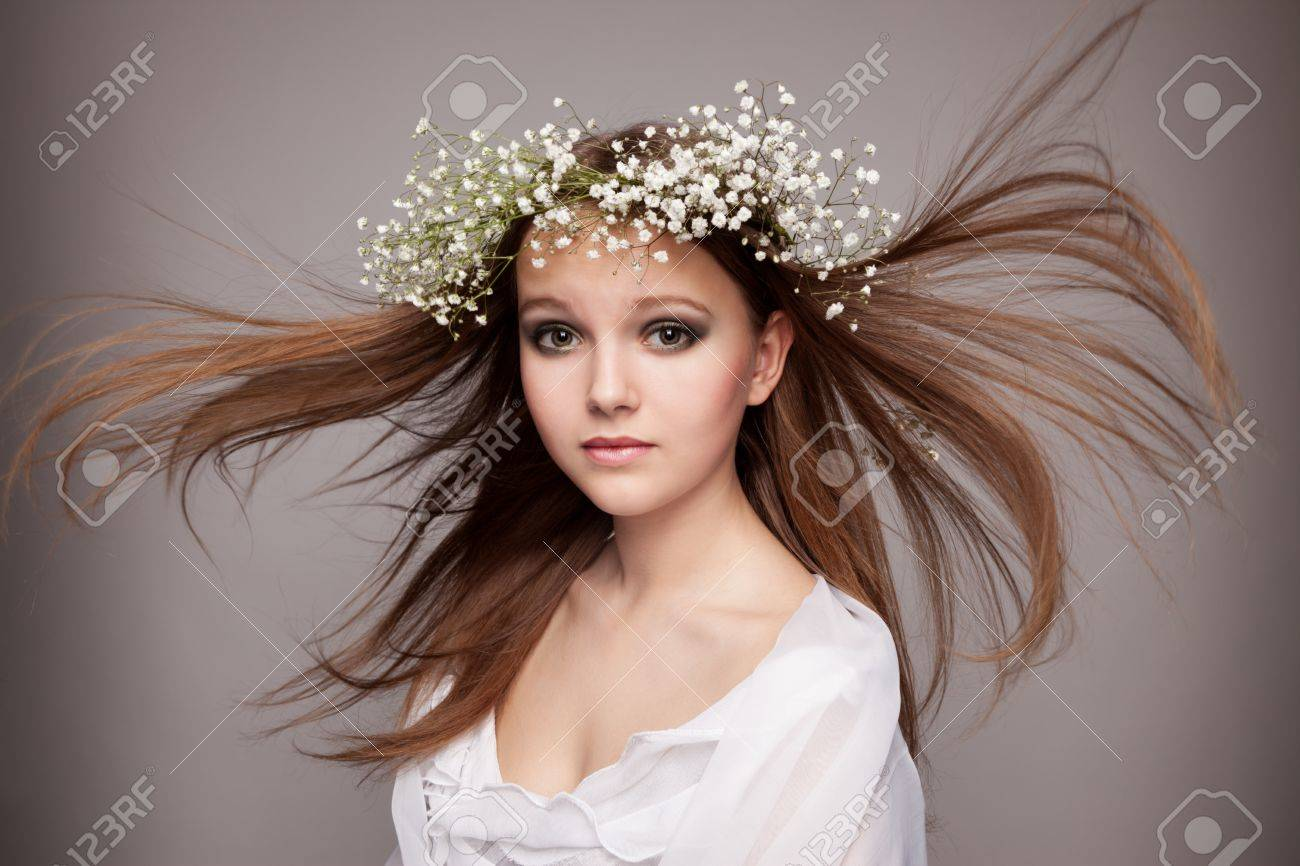portrait of beautiful healthy teen girl with wreath of flowers, on grey Stock Photo - 13570906