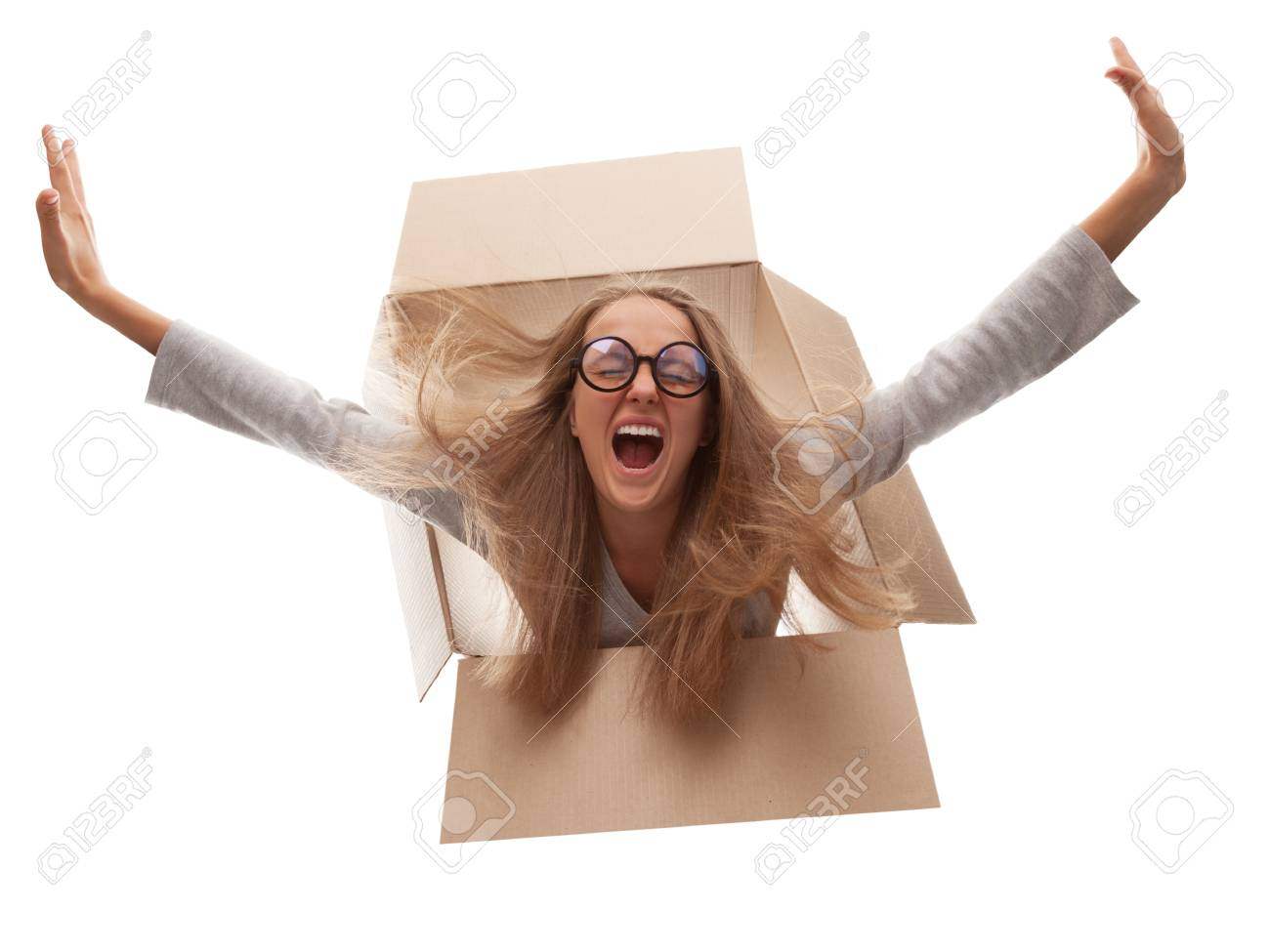 The girl in a cardboard box flies in white background Stock Photo - 15073228