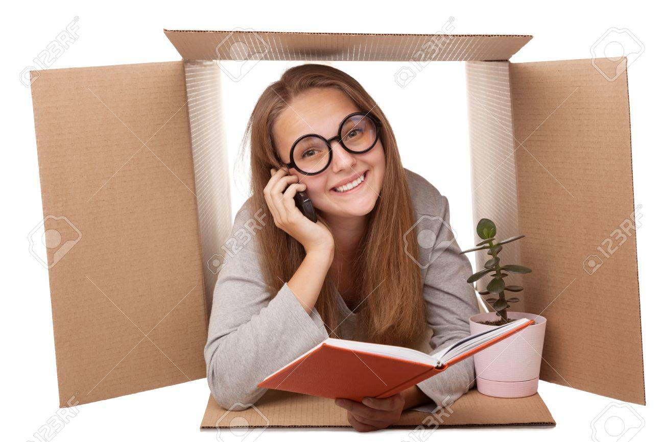 girl has retired to a cardboard box Stock Photo - 15172091