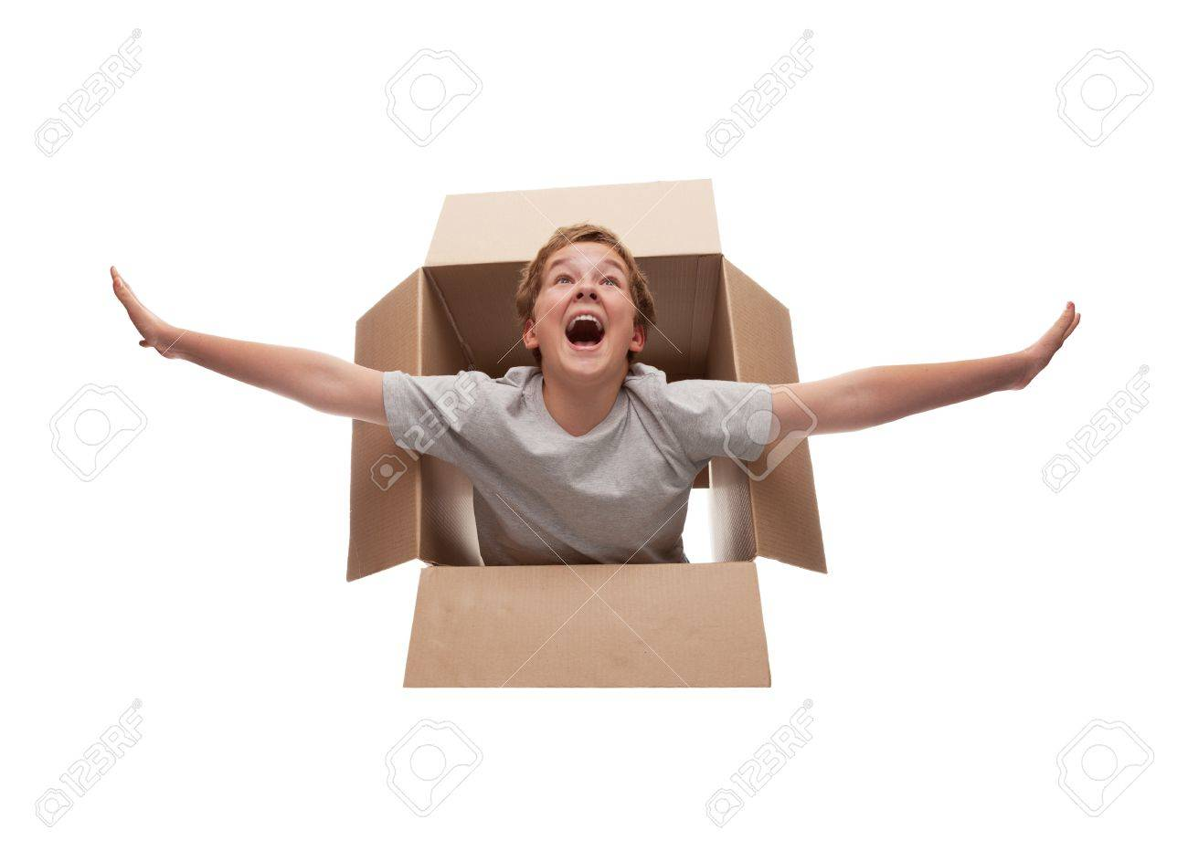 boy in a cardboard box dreams that it flies in an airplane on the sky Stock Photo - 15483031